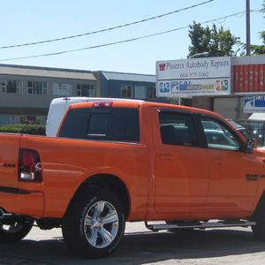Orange truck side angle view